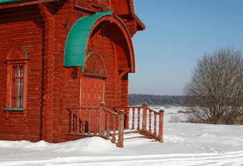 The Russian house from logs in the winter