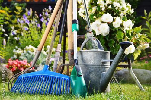 Papiers peints Jardin Watering can and tools in the garden
