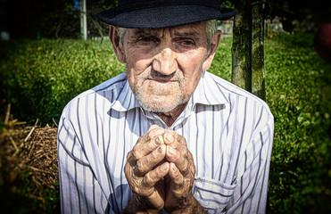 Old man's hands praying