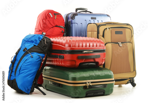 Suitcases and rucksack isolated on white