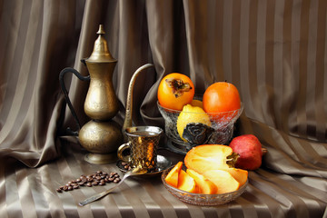Still life with persimmons and coffee set.