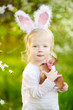 Adorable toddler girl wearing bunny ears on Easter