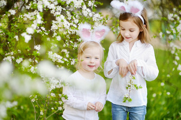 Two little girls wearing bunny ears on Easter