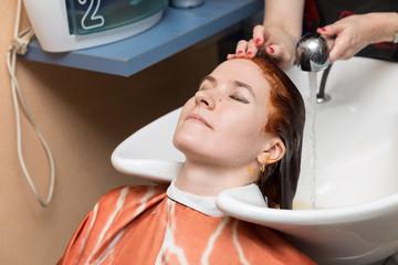 Washing hair in hairdressing salon