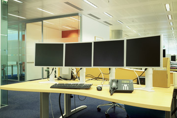 Computer desk with monitors in a modern office