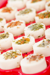 Cheese Appetisers - Soft cheese topped with herbs and spices.