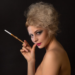 crazy girl with Two-Face makeup and mouthpiece with cigarette