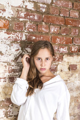 attractive young girl with grungy brick wall background