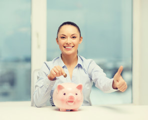 smiling woman with piggy bank and cash money