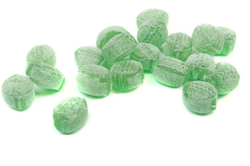 Green mints candy isolated on white background.