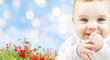beautiful happy baby over poppy field background