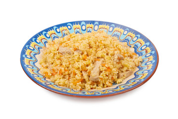 Pilaf dish, bulgur wheat with meat on ceramic plate isolated on