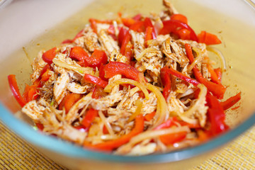 spicy salad with chicken, paprika and onion