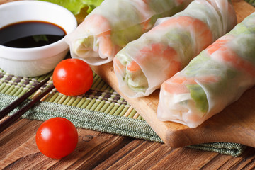 Korean spring rolls with shrimp and sauce close up horizontal