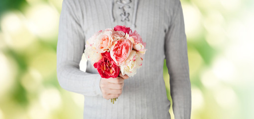 close up of man holding flowers