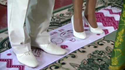 married couple and embroidered towel