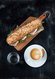 Sandwich (prosciutto, arugula), coffee and water