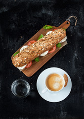 Sandwich with mozzarella cheese, coffee and water