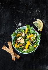 Fresh green spring salad (arugula, yellow pepper, zucchini)