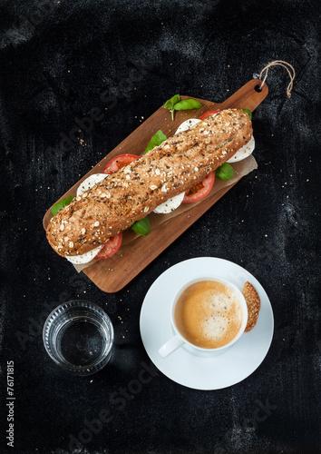Foto op Plexiglas Buffet, Bar Sandwich with mozzarella cheese, coffee and water