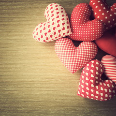 Vintage cotton stuffed hearts over wood
