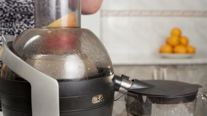 Extractor apple juice in the kitchen