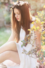 Beautiful young woman in soft spring light