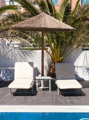 two sunbed in a luxury hotel in Santorini island