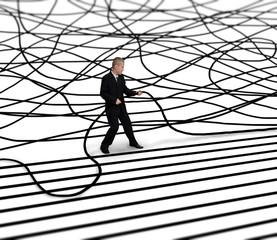 businessman unravels cable