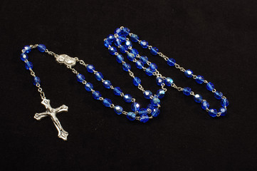Dominican rosary isolated on the black background