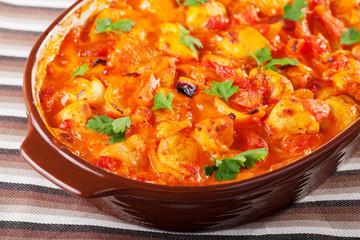 Casserole with chicken, potatos and tomatos