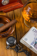 Wealthy man desk, cuban cigars sterling notes, vintage watch and