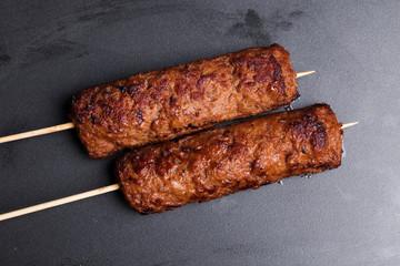lula kebab on wooden skewers dark baking