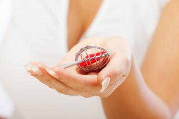 Woman holding heartshaped key