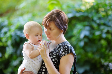 Beautiful middle aged woman and her adorable little grandson