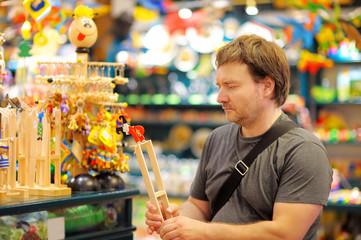 Man at shop of toys