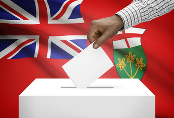 Ballot box with Canadian province flag on background - Ontario