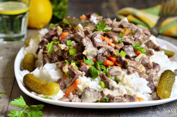 Beef Stroganoff with rice garnish.