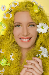 beautiful woman with yellow hair and daisies