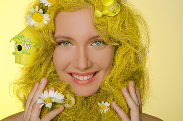 woman with yellow hair and flowers in them.
