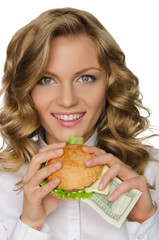 Young woman with burger of dollars