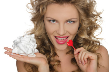 Beautiful young woman with cream and heart