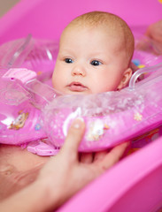 Cute baby girl enjoying bath