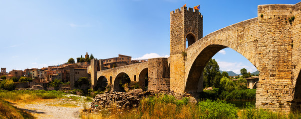 Panorama of medieval bridge with gate