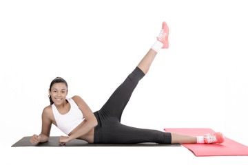 Young woman exercising on floor