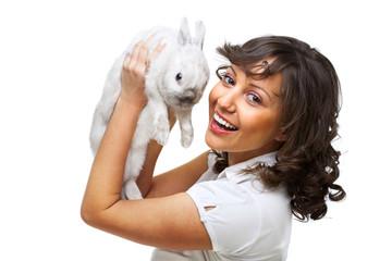 Young woman hugging rabbit