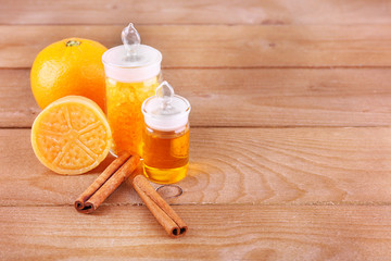 Bottles of essential oil and bath salt with orange, bar of soap