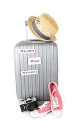 Travel suitcase, converse, photo camera and hat isolated