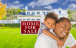 Father and Son In Front of Sale Sign and House