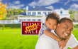Father and Son In Front of Sold Sign and House